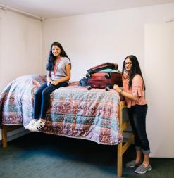 Two participants unpack at their on-campus summer residence.